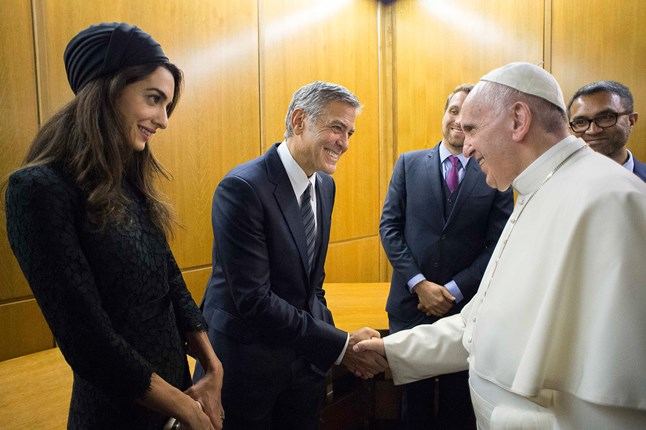 Amal and George Clooney meet Pope Francis at an event held at the Muro o Un Ponte Seminary at Paul VI Hall, at which the actor was awarded a medal for his work with educational organisation Scholas Occurrentes.