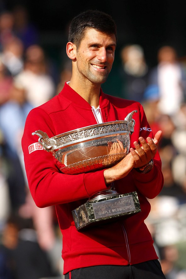 Novak Djokovic celebrates winning the 2016 French Open – beating Andy Murray in four sets - and subsequently becoming the first man to hold all four major international tennis titles since 1969.