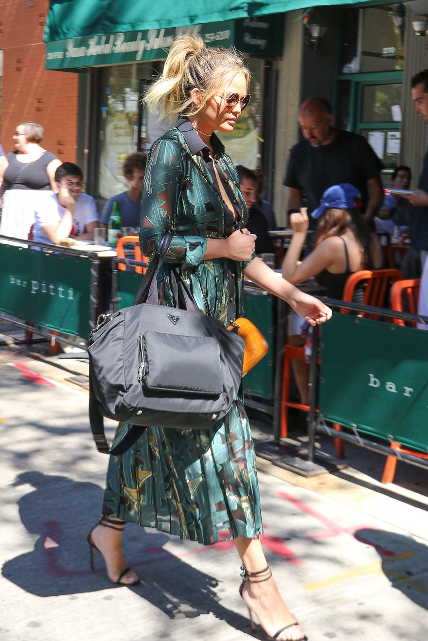 Chrissy Teigen is another example of well-dressed celebrity mothers sporting a classy Prada handbag that doubles as a sleek secret diaper bag.