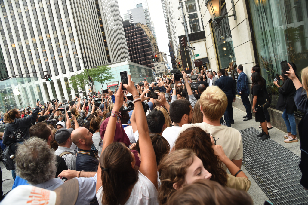 Rihanna draws huge crowd at Bergdorf Goodman for the launch of her Fenty by Puma fall collection.