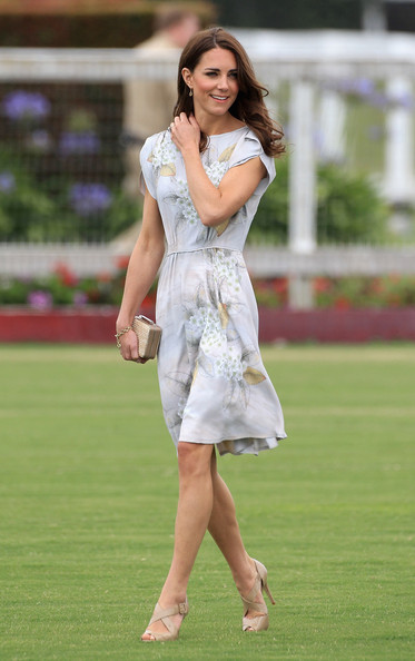 Our favourite royal is polo perfection, in a floaty floral dress, with casual loose curls.