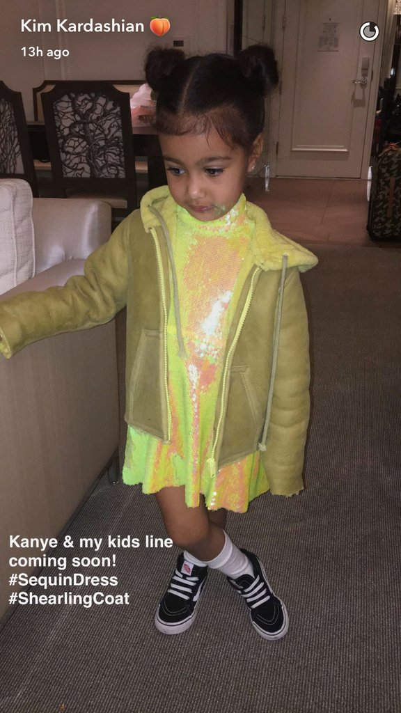 Kim announced via her Snapchat that her and Kanye are creating a kidswear line!  North modelled a chartreuse sequin dress and shearling coat, styled with her Vans sneakers.