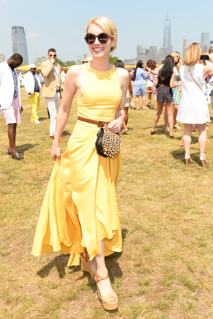 Emma Roberts rocks a maxi dress, in a sunshine yellow hue.  Simple accessories complement her look.