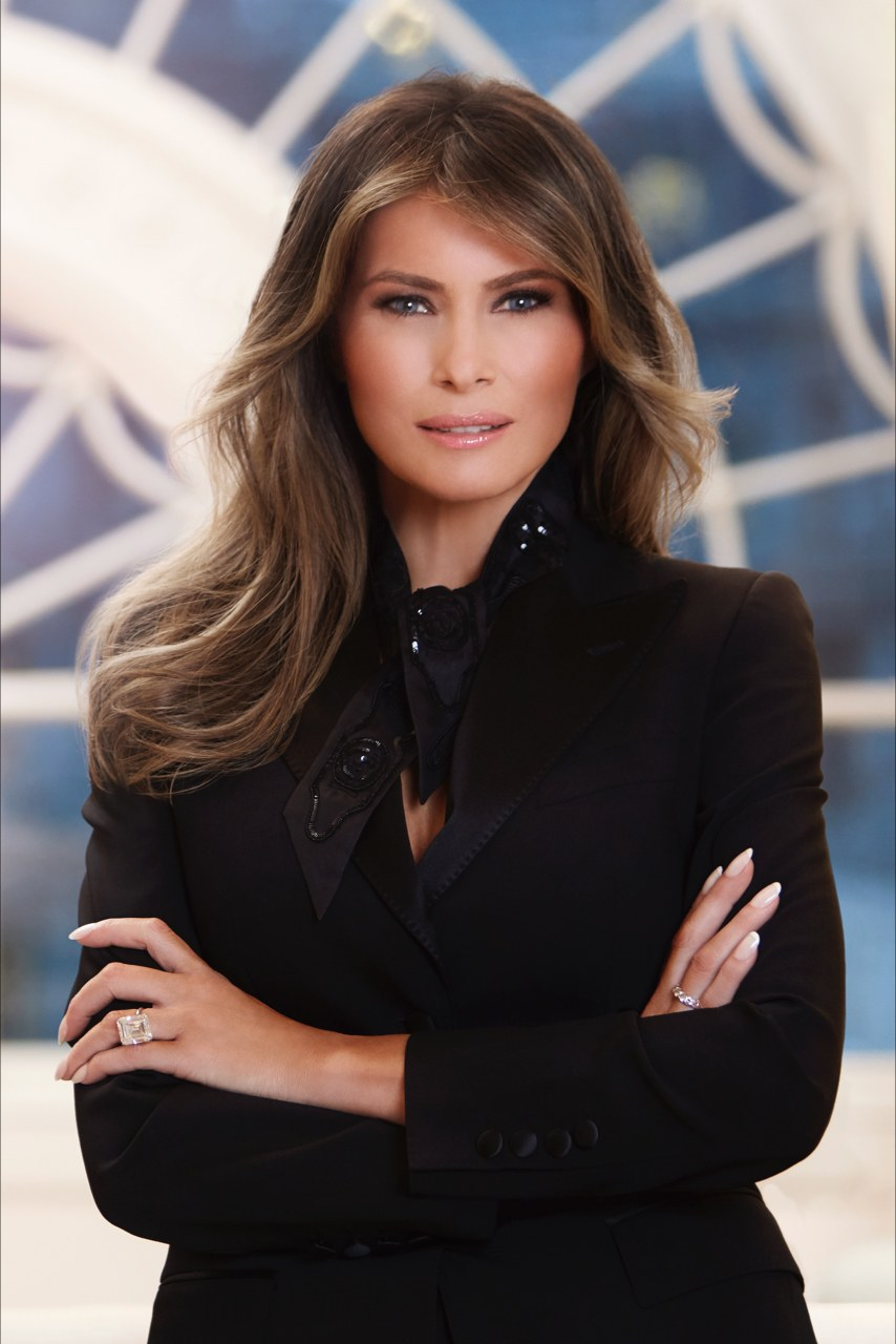 This is Melania Trump's official White House portrait, the designer of her black top and jacket are currently unknown, but her ring is a 25-carat diamond gifted from her husband on their 10th wedding anniversary.