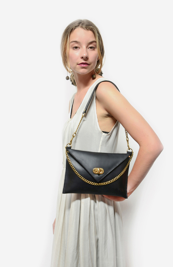 72dpi-221241454f-close-up-clutch-with-strap-ps