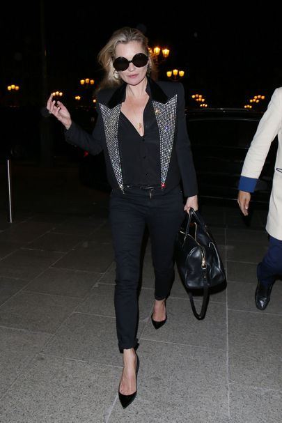 Kate Moss rocked a disco jacket at the Couture Fashion Week after party. Courtesy of Saint Laurent.
