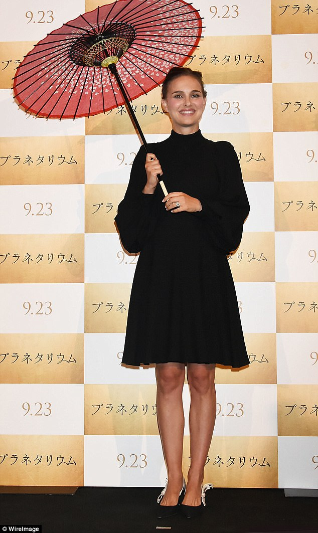 Natalie Portman accessorised with a parasol at the premiere of Planetarium in Japan.