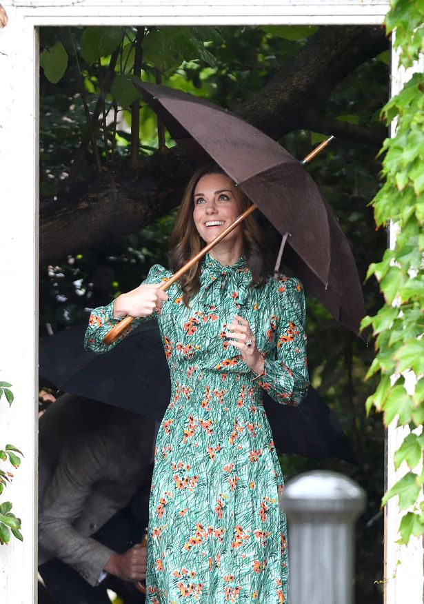 Kate Middleton manages to maintain a chic look while honouring Princess Diana on a rainy August 31st.