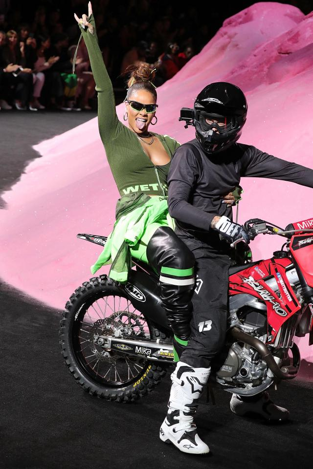 Rihanna rode the back of a motor cycle after her Fenty Puma show.