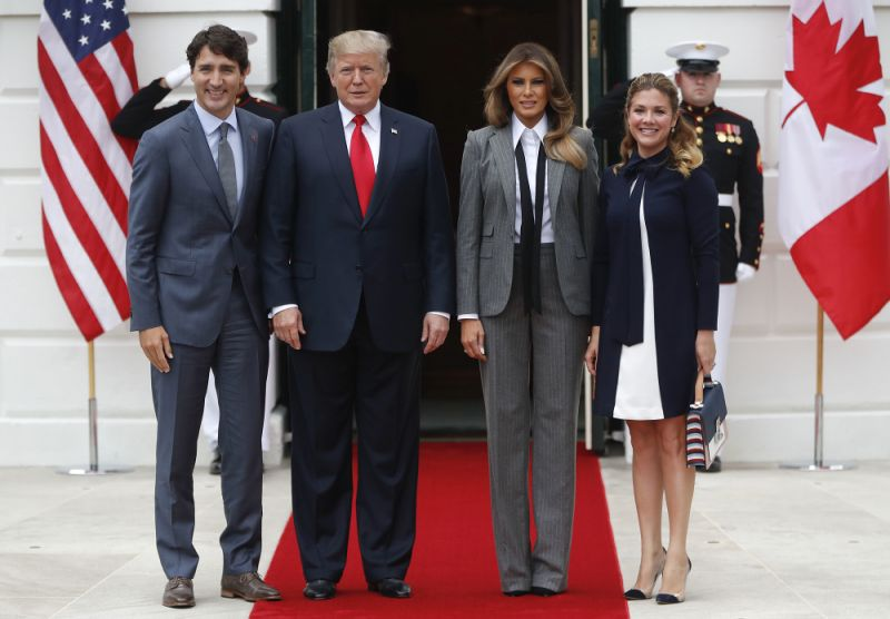 Melania Trump appeared in a pinstripe suit by Ralph Lauren to meet Canadian Prime Minister Justin Trudeau.