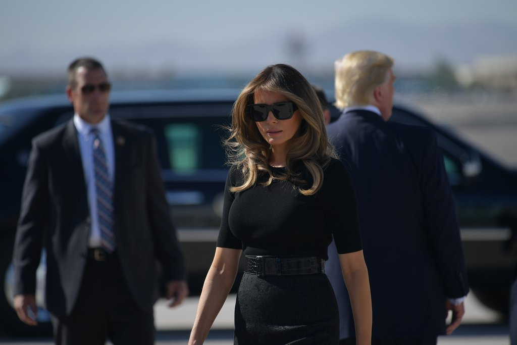 Melania Trump paid her respects to the victims of the Las Vegas shooting by wearing a sombre black ensemble on her visit to the city.