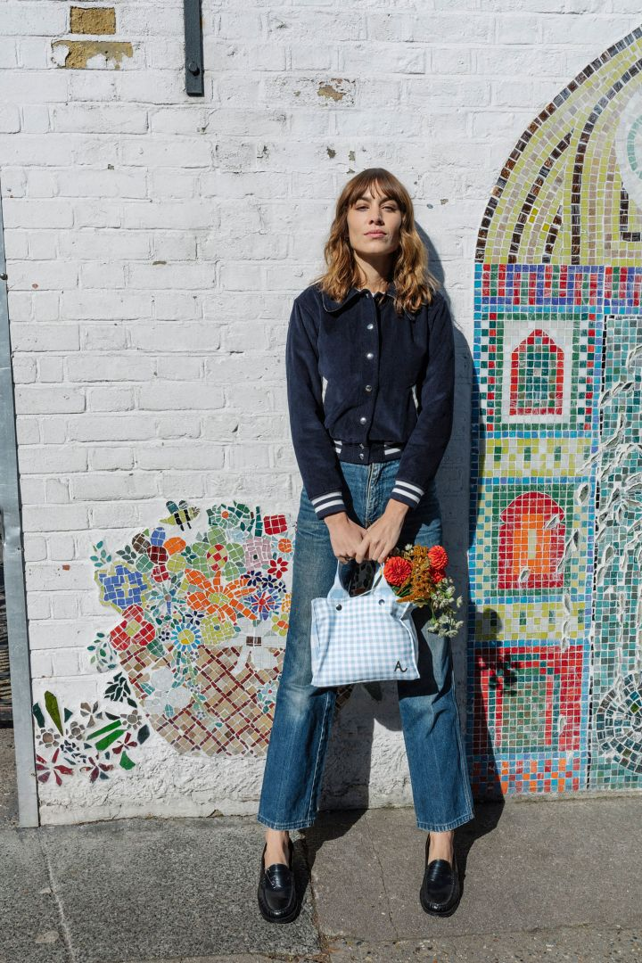 Alexa Chung has designed a handbag for Amex Small Shop, a charity which supports small businesses which give back to communities.