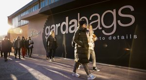 Gardabags outdoor signage with crowd walking past